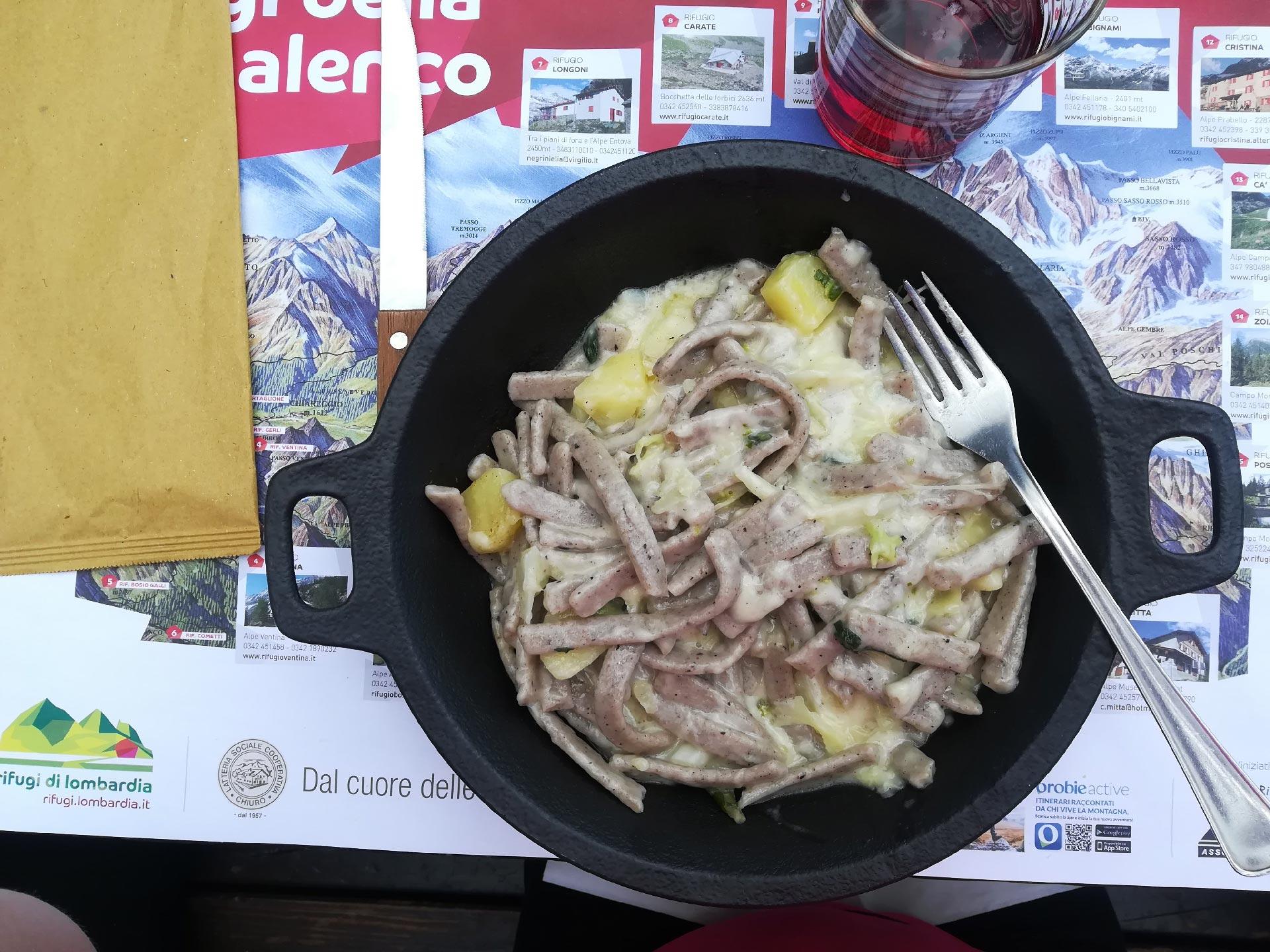 pizzoccheri, piatto tipico valtellinese a base di pasta al grano saraceno accompagnata da patate, verze e bitto (tipico formaggio valtellinese), Valmalenco, Lombardia